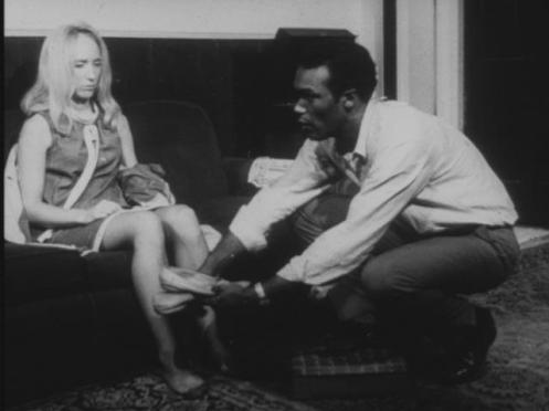 Ben_giving_Barbra_slippers_in_Night_of_the_Living_Dead_bw